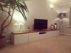 Ikea besta tv hack. Solid oak top and high gloss doors.