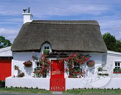 Traditional Irish Houses   ... , Facade of a traditional thatched house, County Waterford, Ireland
