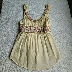 Free People Top Sz 6 Free People Top Sz 6...gorgeous tank with flowers and beading accented by gold piping...satin tie in back...side zip Free People Tops Tank Tops