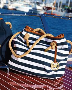 Omg! I need to find some navy/white striped canvas and rope stat, then sew myself a bag like this... I love you MK, but my way would still allow me to buy groceries. :)