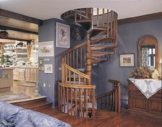 Space around the spiral oak staircase defines its style [From: The Iron Shop]