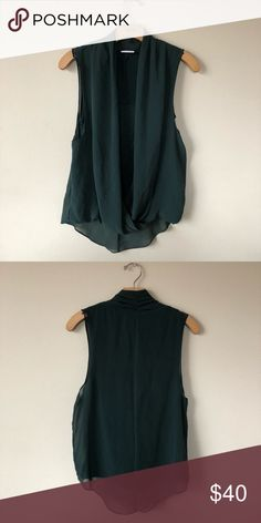 VILA dark green sheer swoop high /Low tank size S VILA size small tank with sheer outside and a built in tank cover. Has a high low feel to it. . Very clean condition no tares no stains. Smoke free home. Opens to offers! VILA Tops Blouses