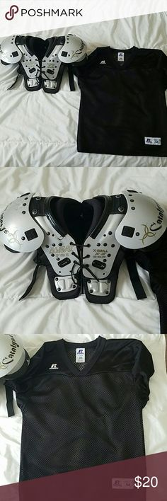 """Youth Football pads and practice jersey Youth Football pads and practice jersey. Pads are size XS 26""""-28"""" and 50-60lbs. Jersey is youth medium and fits nicely over pads! GUC! Shirts & Tops"""