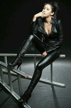 Asian girl wearing black leather jacket leggings front laced high heel knee boots boots #shoeshighheelsfancy #blackhighheelsboots #highheelbootsoutfit