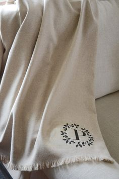NO-SEW MONOGRAMMED WOOL THROW DIY - I would sew the sides, but I like the idea of making a personalized throw for a gift.