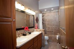 Traditional Master Bathroom - Found on Zillow Digs. Room Cost     Room Estimate    $17,600     Range of Estimate    $12,600 - $25,400     Room Size Estimate    53 sq ft.    Materials: $11,300  Cabinets $1,300 Counters $700 Flooring $600 Paint $100 Electrical $400 Sinks $1,000 Shower $1,300 Bath $1,700 Toilet $300 Mirror $500 Other $3,400  Labor: $6,300  Demolition $1,700 Counters $100 Flooring $800 Paint $400 Electrical $500 Sinks $300 Shower $1,500 Bath $1,000