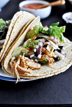 Crockpot Cheddar Beer Chicken Tacos (Use 6 chicken thighs, omit salt & tortillas = 287mg Sodium). Serve on 1/2 cup brown rice and lettuce, and top with 1/4 cup low sodium or homemade black beans, chopped tomato, a slice of avocado and a tbsp fat free sour cream.