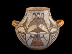 Acoma Pottery Jar With lug handles at shoulder, painted with abstract designs and a full Kachina.