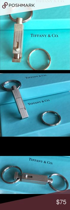 Tiffany & Co. Sterling Silver Key Valet. Tiffany & Co. Sterling Silver Key Valet. .925 signed by Tiffany's. Engravable – signs of wear, price reflects! See pic #4 - this key fob  is selling on eBay for over $300. This was my Father's  patented invention and sold them to Tiffany's for years. The sample piece has been handled but never used – many scratches but engraveable to camouflage some of them. Tiffany & Co. Accessories Key & Card Holders