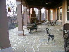 Beautiful #stone #patio with outdoor #fireplace by DH Landscape Design