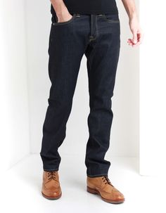 These regular tapered Edwin jeans in unwashed/raw denim have a classic five pocket design with contrast orange top stitching and silver hardware including an all button fly and large rivets to the front pockets. Edwin Jeans, Raw Denim, Top Stitching, Clothing, Summer, Pants, Men, Tops, Fashion