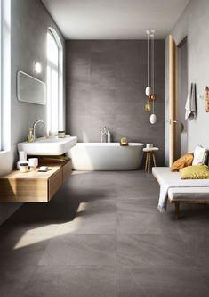petite salle de bain moderne carrelage effet beton baignoire ilot #bain #moderne #bathroom