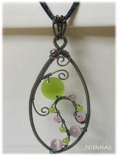 Copper wire wrapped pendant with cats eye in a silk cord
