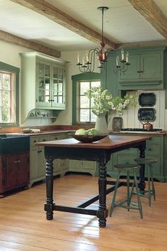 Cottage Kitchen with Farmhouse Sink, Harvest Style Kitchen Island from Reclaimed Hardwood with Turned Legs, Exposed beam