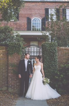 Bride and groom at the Davenport House Museum in Savannah, GA. Styling by Design Studio South, florals by A to Zinnias, image by Mackensey Alexander Photography. Bride's dress from BleuBelle Bridal in Savannah, hair and makeup by B Street Salon. #wedding