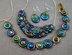 This is a custom set that includes a necklace, bracelet and matching earrings. Made of polymer clay with shimmery powdered pigments and Swarovski crystal elements. Terracotta Jewellery Designs, Terracota Jewellery, Funky Jewelry, Jewelry Art, Jewelry Design, Jewelry Ideas, Polymer Clay Necklace, Polymer Clay Beads, Bubble Necklaces