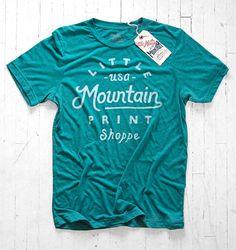 Little Mountain Print Shoppe. Canvas & Bella, Tri-Blend Teal. 3.4 oz. 50% polyester / 25% cotton/ 25% rayon.