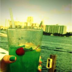 Miami dolphins drink 1/2 oz Malibu Coconut Rum, 1/2 oz Captain Morgan Original Spiced Rum, 1/2 oz Blue Curaçao Liquor, 1/2 oz Vodka, 1/2 oz Lemonade, 1 oz Lemonade