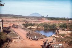 Nui Ba Den 1967 the Black Virgin Mountain looms in the background as our convoy of the 2nd Battalion, 77th Field Artillery Regiment, 4th Infantry Division crosses the Saigon River NW to Loc Ninh to support our infantey units from an Artillery FSB.