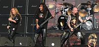 Thrash Metal-- is an extreme subgenre of heavy metal music characterized by its fast tempo and overall aggression. The songs usually use fast percussive beats and low-register guitar riffs, overlaid with shredding-style lead work. The lyrics often deal with social issues and reproach for The Establishment, using direct and denunciatory language, an approach which partially overlaps with the hardcore genre.