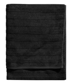 Bath towel in thick cotton terry with woven, striped texture. Hanger loop on short sides