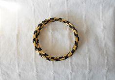 Black & gold bugle bead memory wire bangle