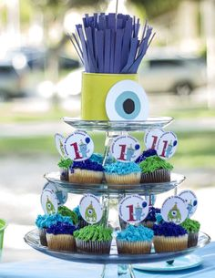 Such cute monster topped cupcakes! diy cake toppers and monster eye centerpeice