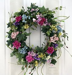 This Garden Beauty wreath is an artificial wreath that has multiple colors of the rainbow silk flowers and artificial greens nestled on a natural grapevine wreath base. A beautiful spring and summer wreath measuring in diameter. Diy Wreath, Grapevine Wreath, Wreath Ideas, Wreath Making, Spring Front Door Wreaths, Spring Wreaths, Silk Flower Arrangements, Pastel Floral, Summer Wreath