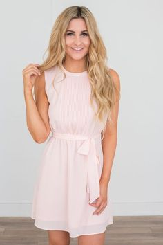 Shop our Tie Waist Sleeveless Chiffon Dress in Soft Pink. Featuring a pintuck detail and fully lined. Free shipping on all US orders!