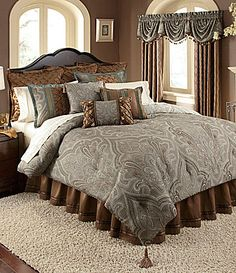 I really like the colors in this bedding collection.  For the record, I would probably not paint the walls brown - as attractive as the color itself is, it emphasizes the brown too much instead of the blue.