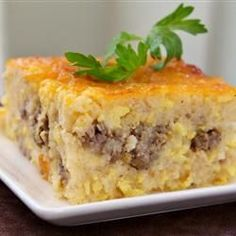 Southern Grits Casserole -whether you are from the south or not - this breakfast casserole is a crowd favorite and always requested over and over again at my house! I add a can (or two) of chopped green chile's for extra flavor (but no heat). If I want to kick it up a notch on the heat level I will add about 1/2 tsp of cayenne pepper. (I do not scramble the eggs, rather fold them in to the grits)
