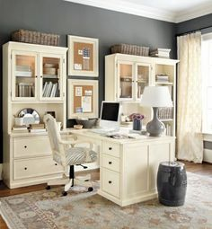 Elegant home office design interior using white office furniture completed by gray table lamp and computer on top also zebra pattern office chair and classic rug over wooden floor and dark gray wall paint color.