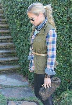 plaid with jewels and leather. cargo vest, plaid shirt, chambray shirt, popped collar, leather leggings, glitter bow belt, tortoise michael kors watch, gold hair tie