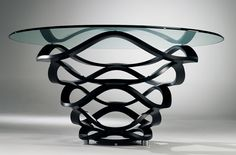 Dining table with base in antiqued wrought iron in colour gree or rust-brown available also with gold or silver leaf finish. Glass top 19 mm th without bevel. REFLEX ANGELO