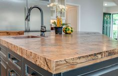 Reclaimed wood counter island with hammered copper sink