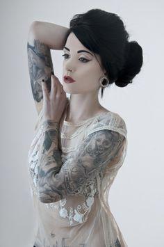Beautiful inked woman - sleeve tattoo