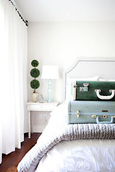 """Aside from ditching your twin bed, buying a headboard is the ultimate """"I've made it"""" moment. And if you don't want or can't have a headboard, at least consider these stylish alternatives. You're welcome.  Photo by Sharla Pike via Style Me Pretty"""