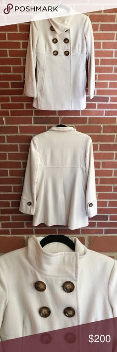 """Michael Kors Cream Pea Coat Michael Kors Cream Pea Coat  6 buttons in the front and 1 button on each sleeve.  Armpit to armpit  18.75"""" Entire length shoulder to bottom 29.25""""  See picture 7 for fabric content.  Excellent Condition! I wore this twice. Let me know if you have any questions! ✅ I LOVE OFFERS ✅ INSTAGRAM: @ocaputostyle MICHAEL Michael Kors Jackets & Coats Pea Coats"""