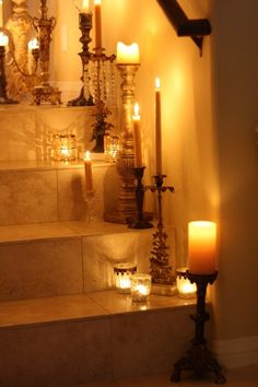 I am doing this with battery-operated candles. The flames would be way too dangerous on stairs! Add ribbon and tuck greenery into the candlesticks or add candelabra jewelry. Chandelier Bougie, Chandeliers, Kwanzaa, Candle Lanterns, Candle Sconces, Feng Shui, Vibeke Design, Candle In The Wind, Wall Lights