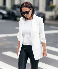 white blazer with leather trousers and sunglasses