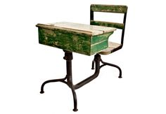 Child's Schoolhouse Desk c. 1920's - Vintage child's schoolhouse desk with original green painted wood and iron base, cubby hole for books, and hole for glass inkwell. www.charlieford.com