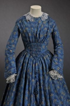 Indigo blue dress with printed leaf pattern, circa 1845-1850, via MODE MUSEUM HASSELT.