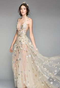 Sequined stars twinkle all over the delicately sheer tulle that floats above the barely-there lining. This plunging V-neck gown will have you looking like a celestial ballerina on your special day.