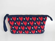 A zip clutch tapestry crochet pattern for those of you that want a little bit of a challenge. Take tapestry crochet to the next level by working more than two colors at a time. Three contrasting colors give it a fun modern look. Tapestry Crochet Patterns, Knit Patterns, Crochet Stitches, Crochet Hooks, Double Crochet, Single Crochet, Clutch Pattern, Best Leather Wallet, Cotton Cord