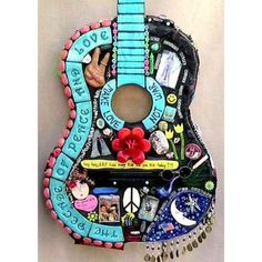 """Wow! A """"scrapbooked"""" guitar :D How cool! I want this!!"""