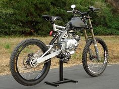 Motoped | Motorized Bicycle. Not technically a motorcycle, but I'd ride the hell out of it!