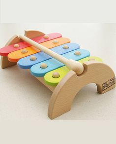 A birght and colourful Beech wood XylophoneBright and colourful, this durable beech wood uses coloured stains that wont chip no matter how hard you play with it.This xylophone is a great hand to eye co-ordination toy. Complete with wooden beater for hours of musical fun. Comes in a quality attractive colour box. <em>Designed for children aged 12 months plus.</em>Beech wood<em>L22cm x H7cm x D16cm</em>