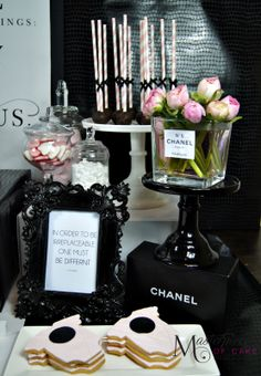 Chanel themed sweet/dessert table close-up for a baby shower. Styling, sweets and picture by Masterpiece Of Cake.