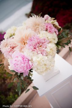 Soft pink peonies and peach dahlias with white hydrangea on a custom built white pillar by A Good Affair Wedding  Event Production [Photo Cred: Dapper Images]