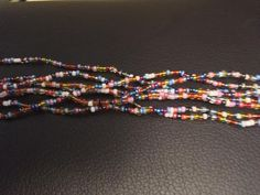 Three Stands of Waist Beads Beads are customarily tied on by the wearer, it`s...